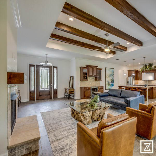 Stone Crest model living room with wood beams